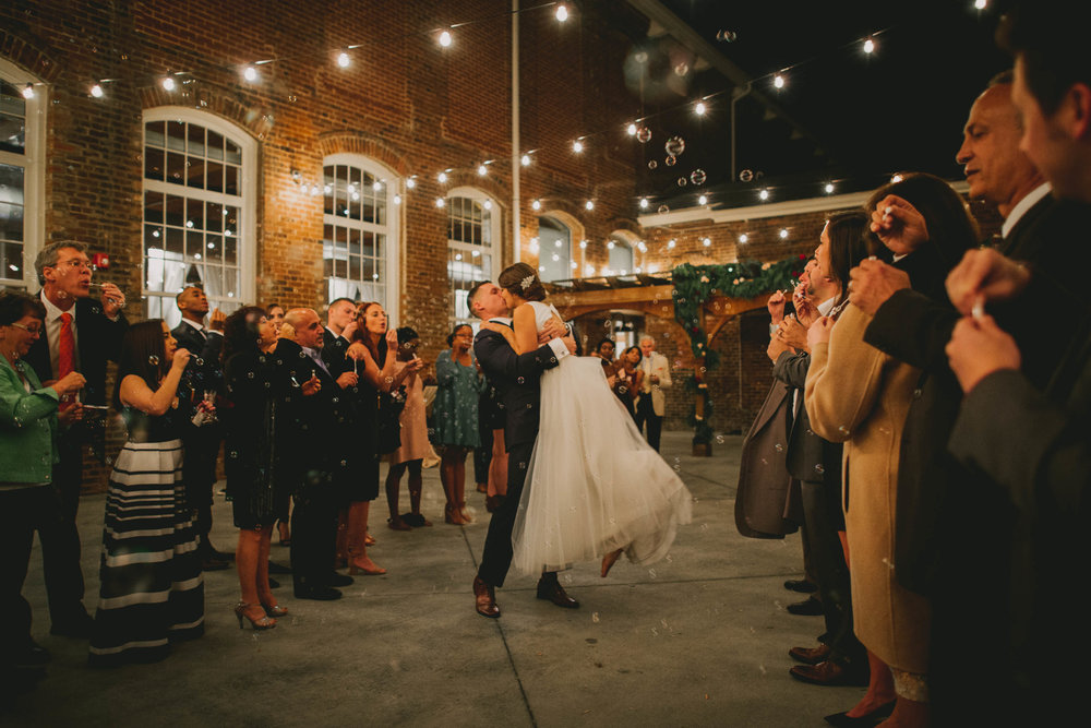 bride and groom kissing during bubble exit