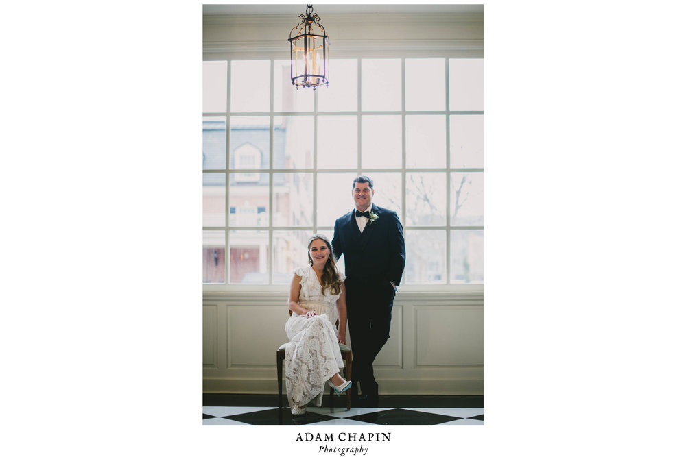 bride and groom sitting in the window light of the Carolina Inn