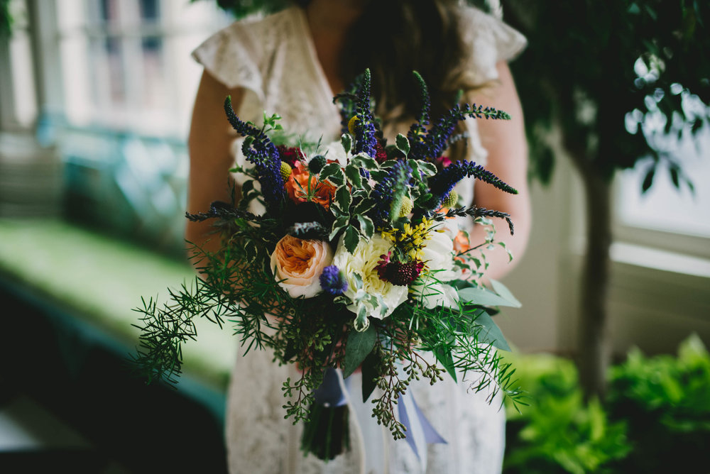 the bride holding her gorgeous bouquet from University Florist