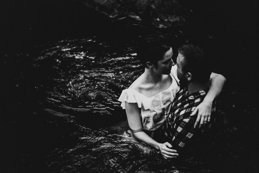 Couple embracing in the Eno River during their Durham engagement photos