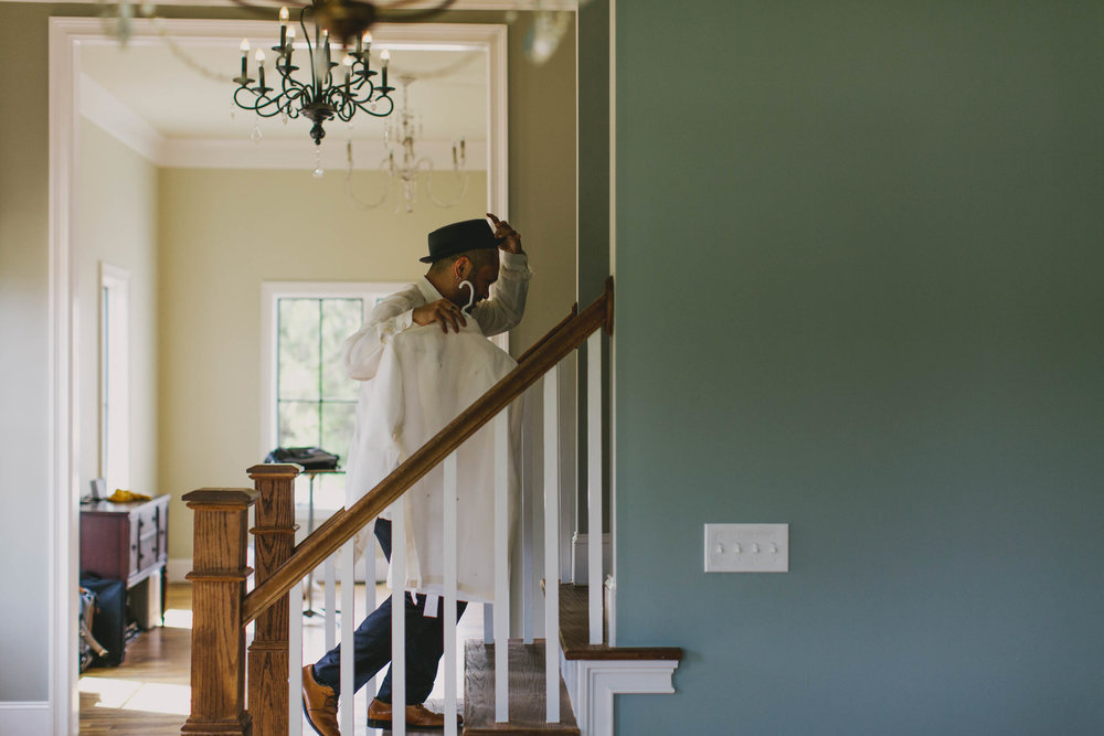 groom running upstairs to change before wedding