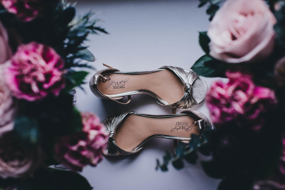 bride's shoe details with bouquets