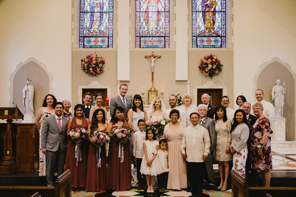 family photo after wedding inside Sacred Heart Cathedral