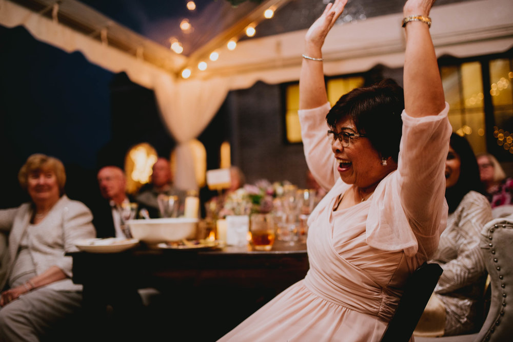 groom's mother celebrating during toast