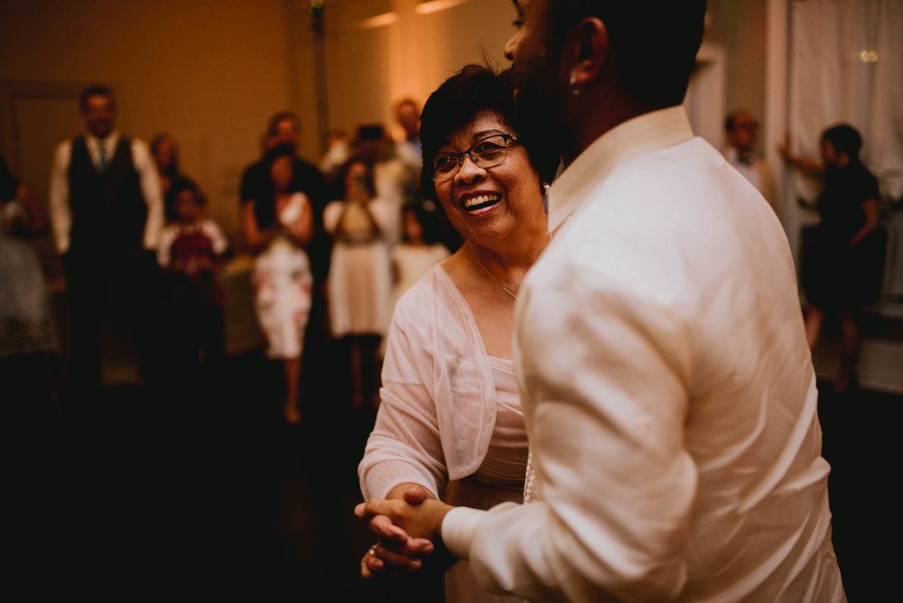 groom and his mother dancing during mother-son dance