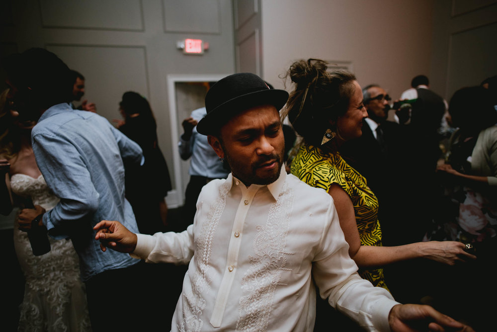 groom dancing during wedding reception