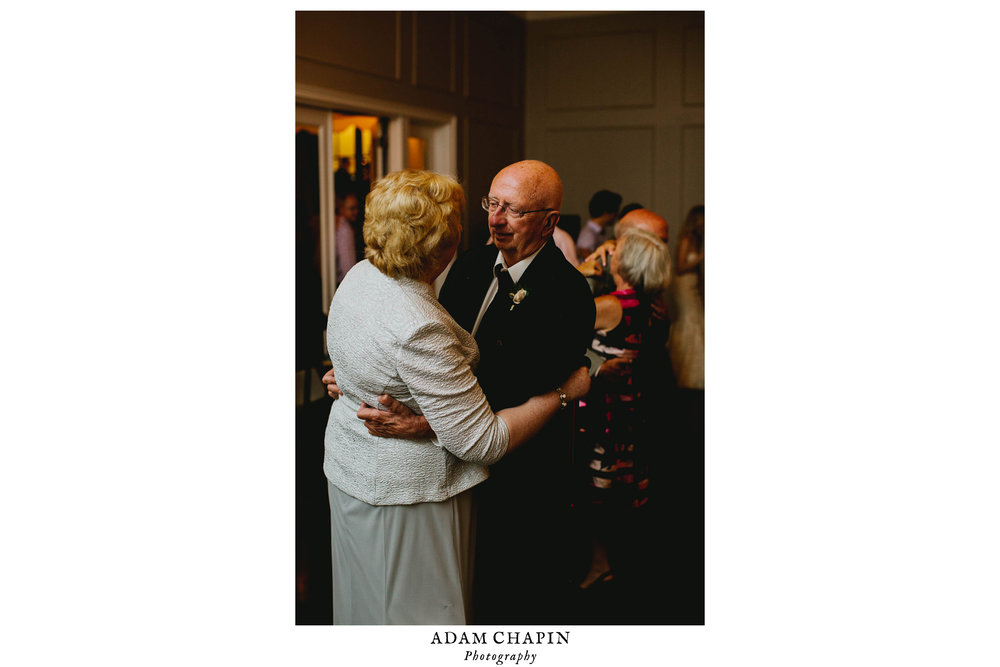mother and father of bride sharing a dance during wedding reception
