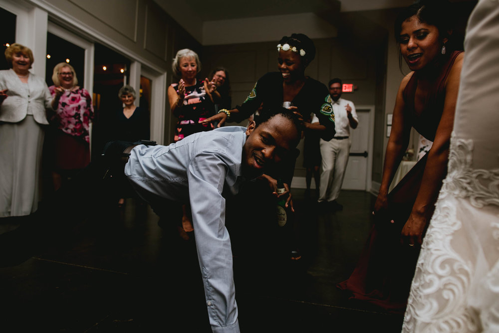 wedding guests getting lit during wedding reception