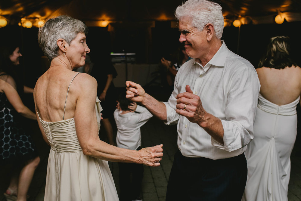 mother and father of the bride dancing during reception at their daughter's Jiddi Space and Courtyard Wedding at Sitti Restaurant