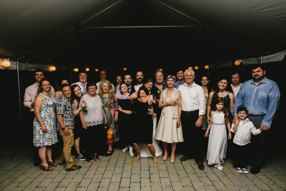 all the wedding guests pose for a group photo at this Jiddi Space and Courtyard Wedding at Sitti Restaurant