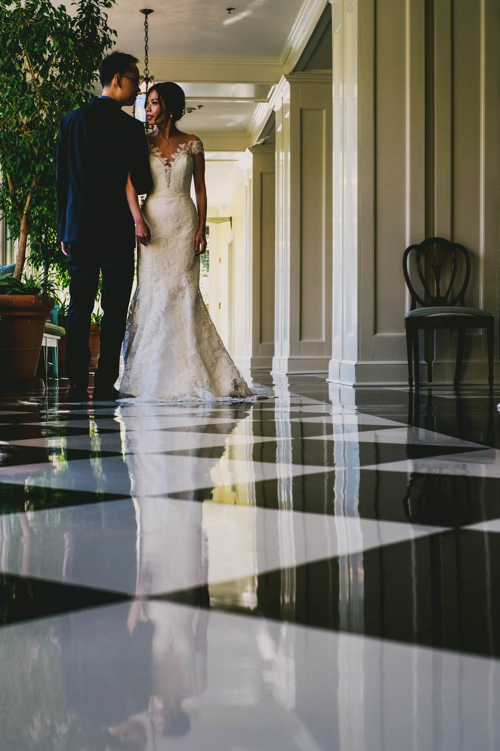 couple embraced in checkered hallway of the carolina inn