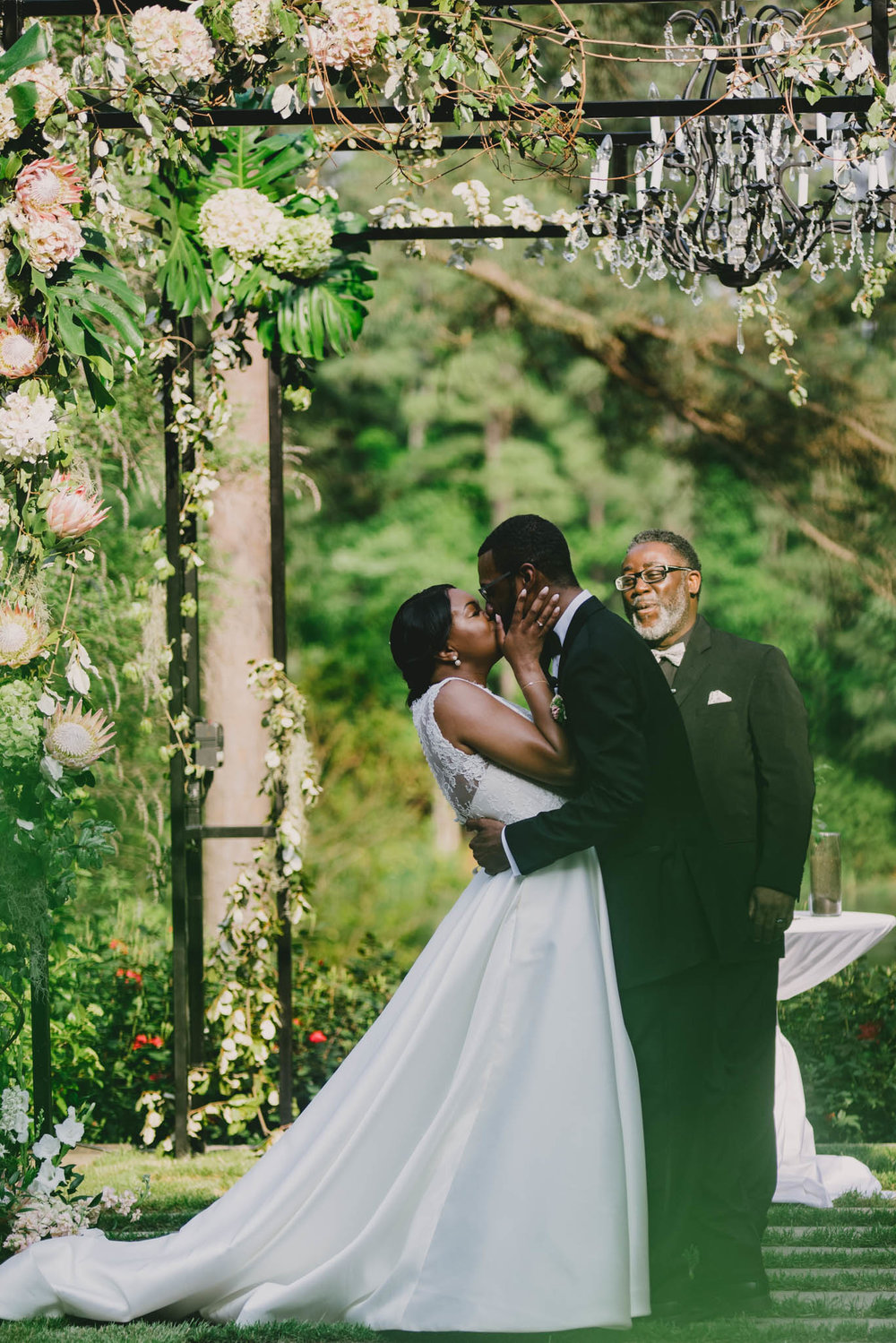 bride and groom sharing their first kiss during their wedding at the Umstead Hotel and Spa