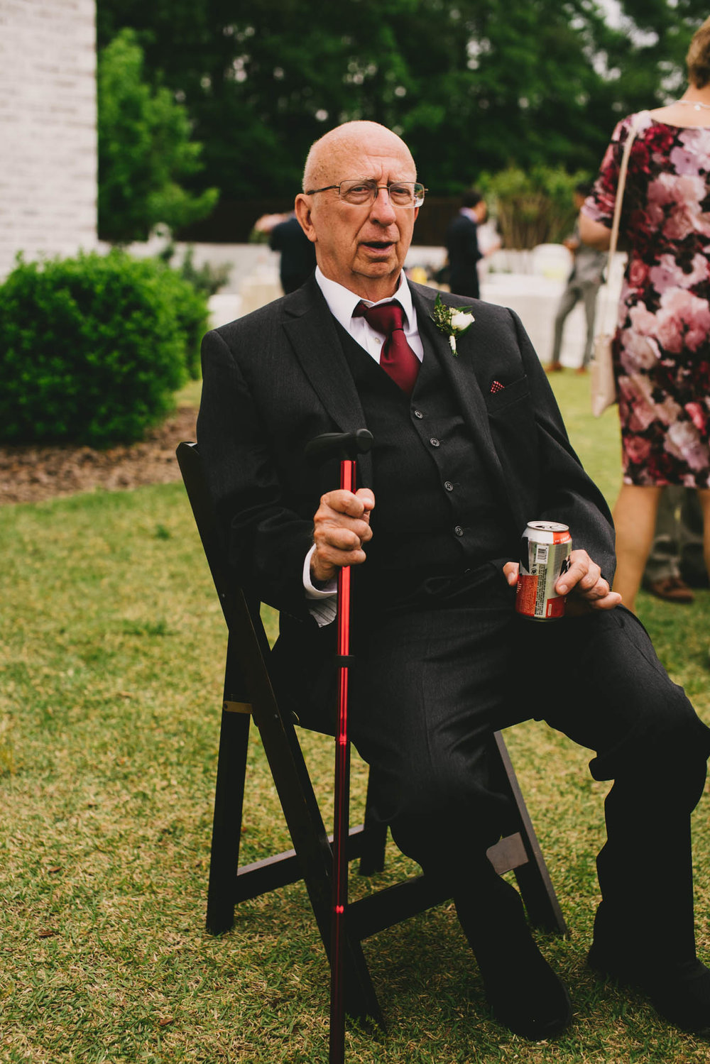father of the bride enjoying a beer at the Bradford wedding reception
