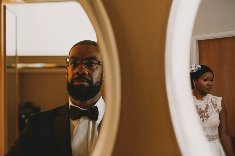 a double exposure of the bride and groom getting ready in their separate rooms before their Umstead Hotel wedding