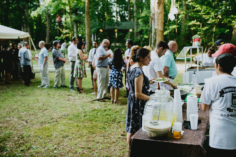 wedding guests line up for tacos