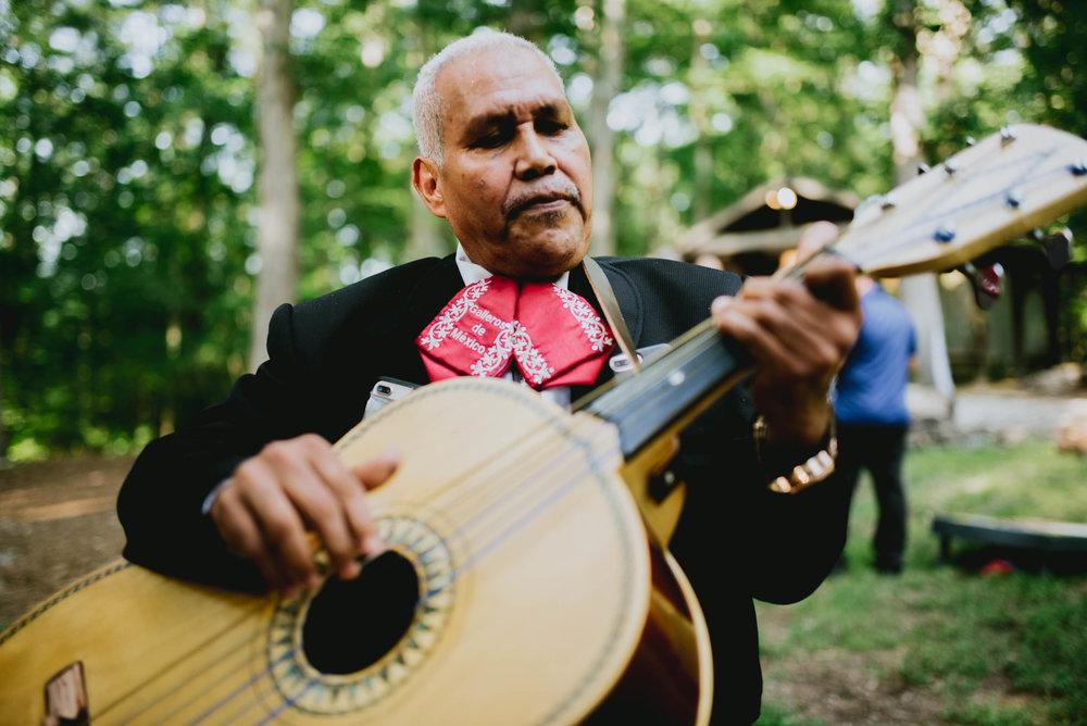 mariachi playing the guitarron