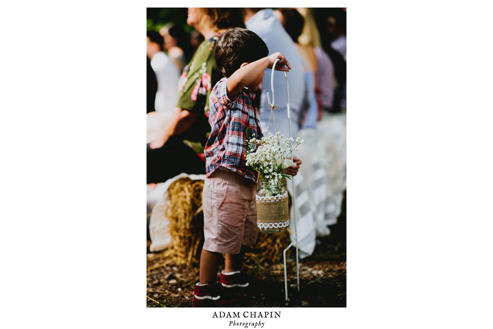 wedding guest child playing with flowers