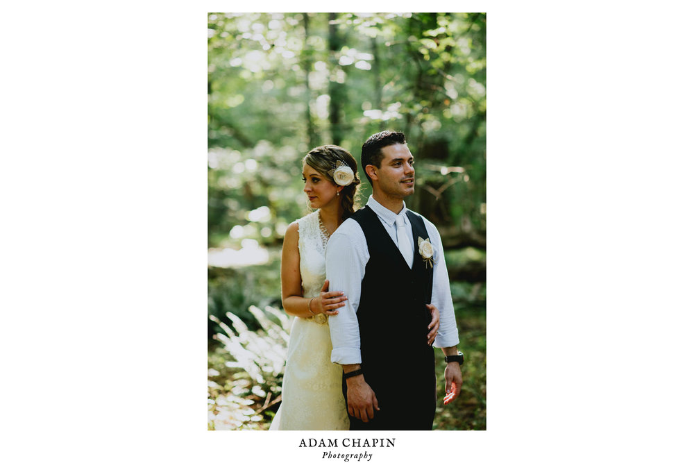 bride and groom standing in the forest after their duke forest wedding