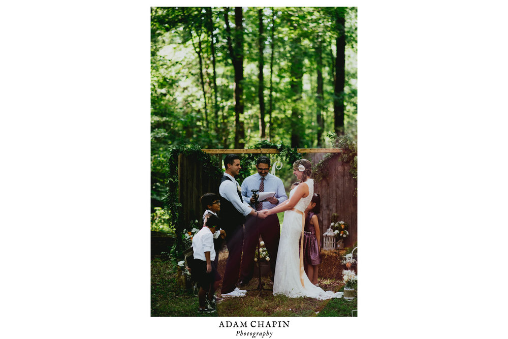 bride and groom laughing during Duke Forest wedding