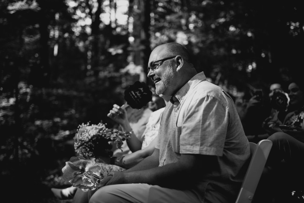 father of the bride smiling during ceremony