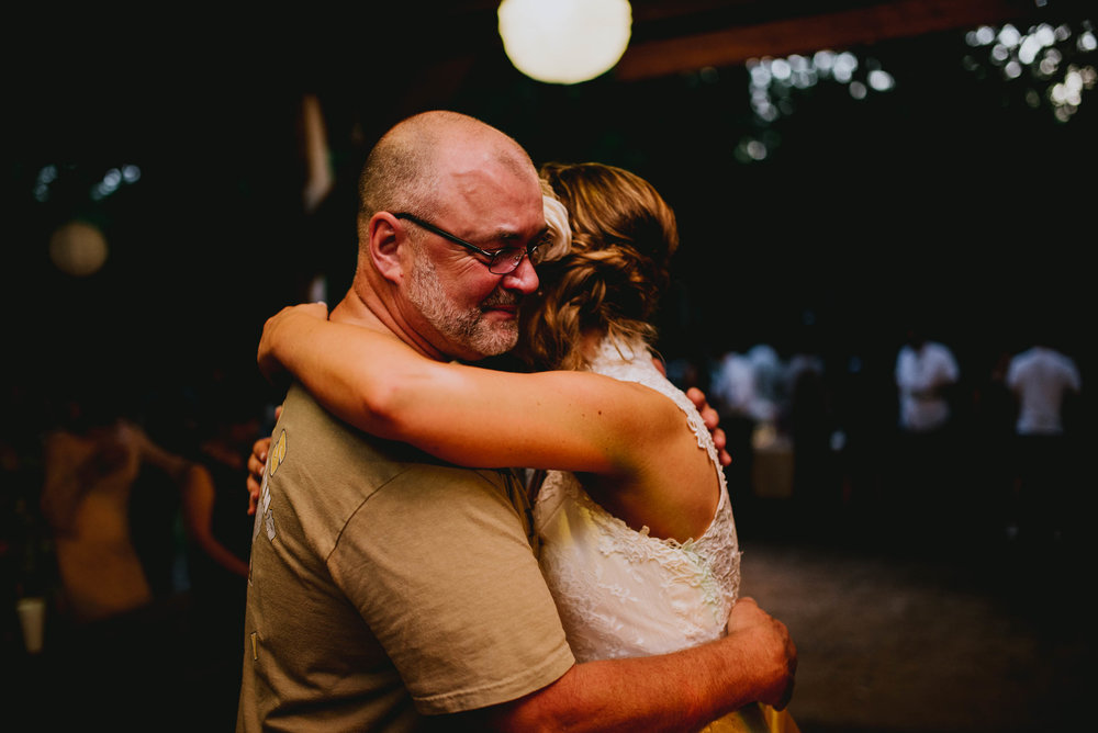 bride and her father embracing during father-daughter dance