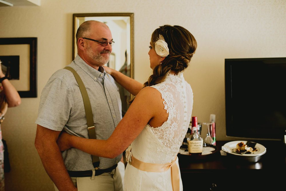 father of the bride and his daughter seeing each other for the first time