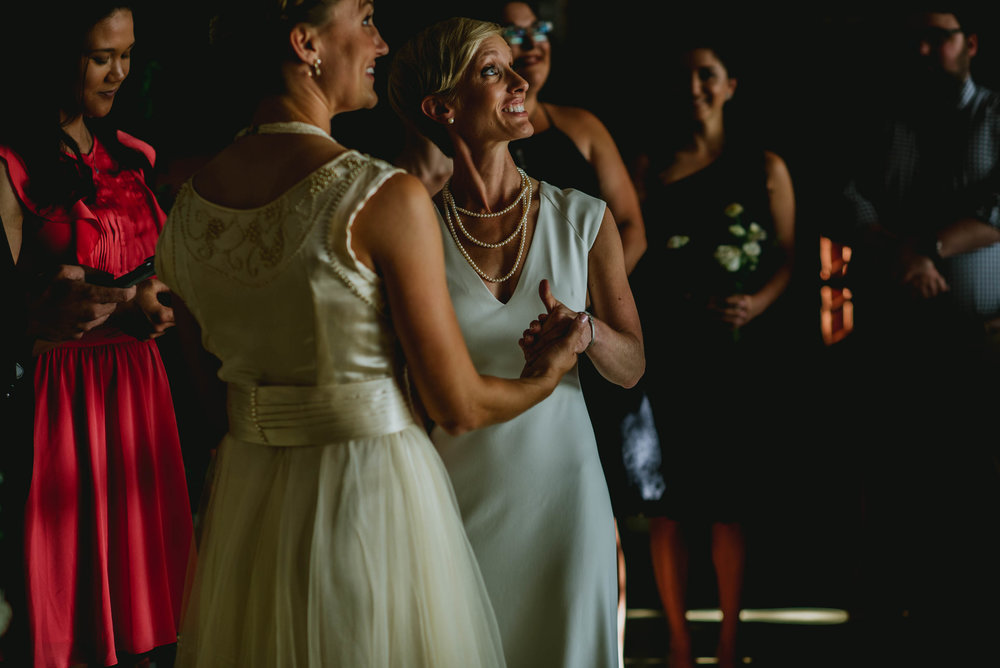 brides look up to balcony during ceremony