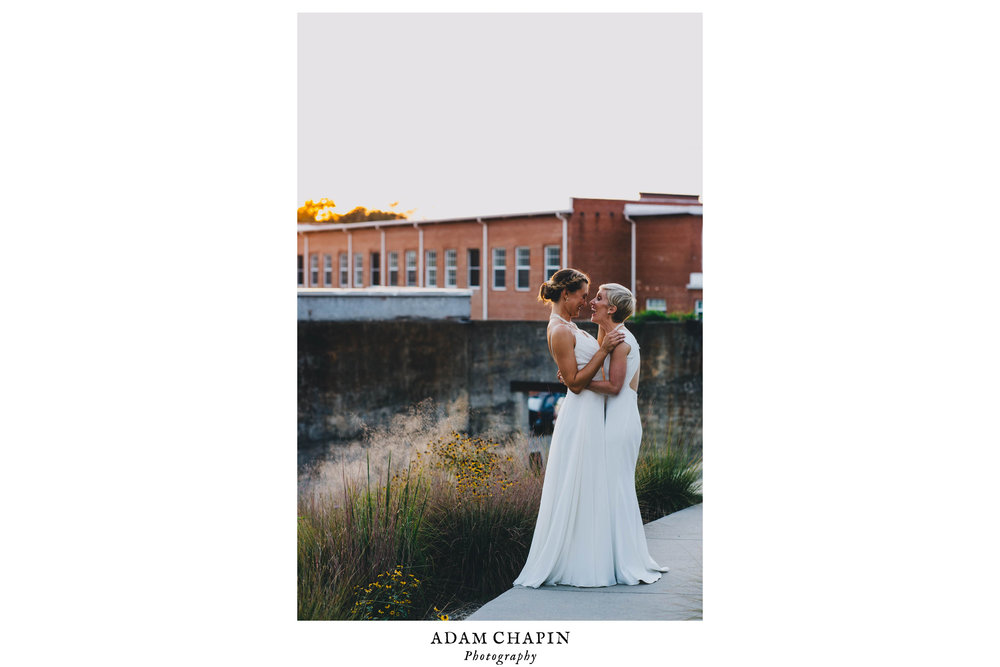 brides loving on each other just after their haw river ballroom wedding
