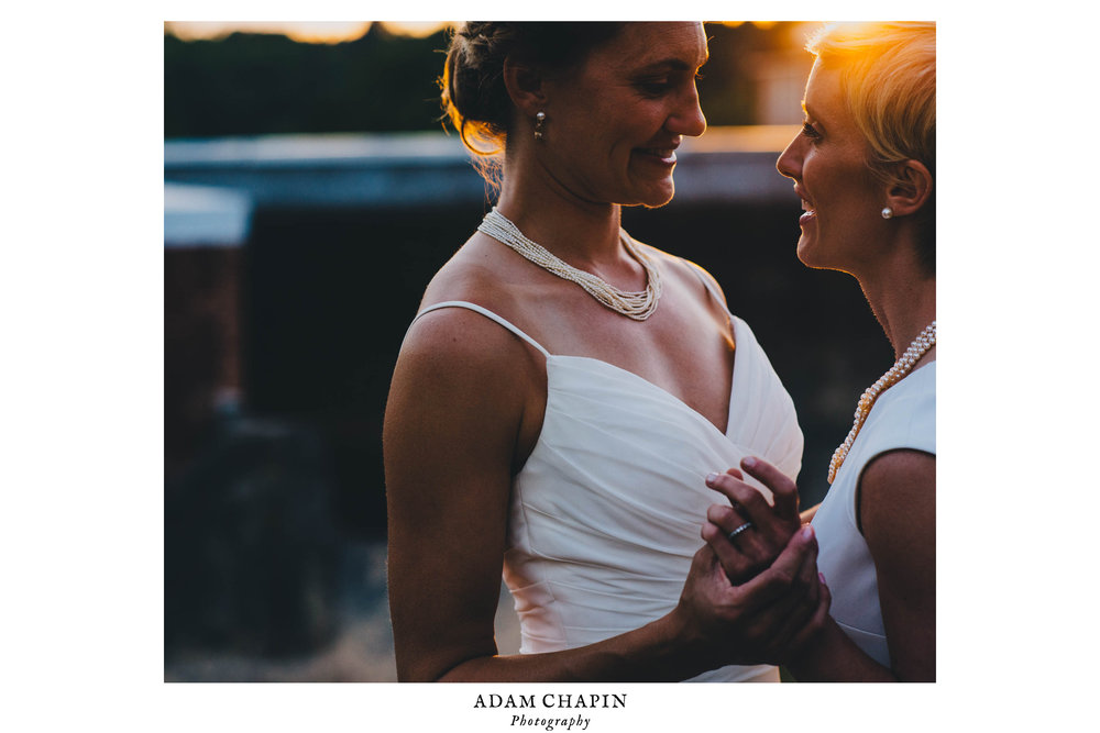 brides basked in the sunset over the haw river ballroom in saxapahaw north carolina