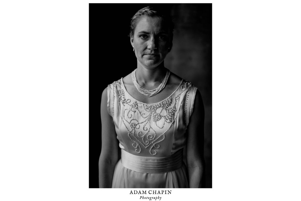 black and white portrait of bride wearing her great grandmothers 1929 wedding dress at the haw river ballroom