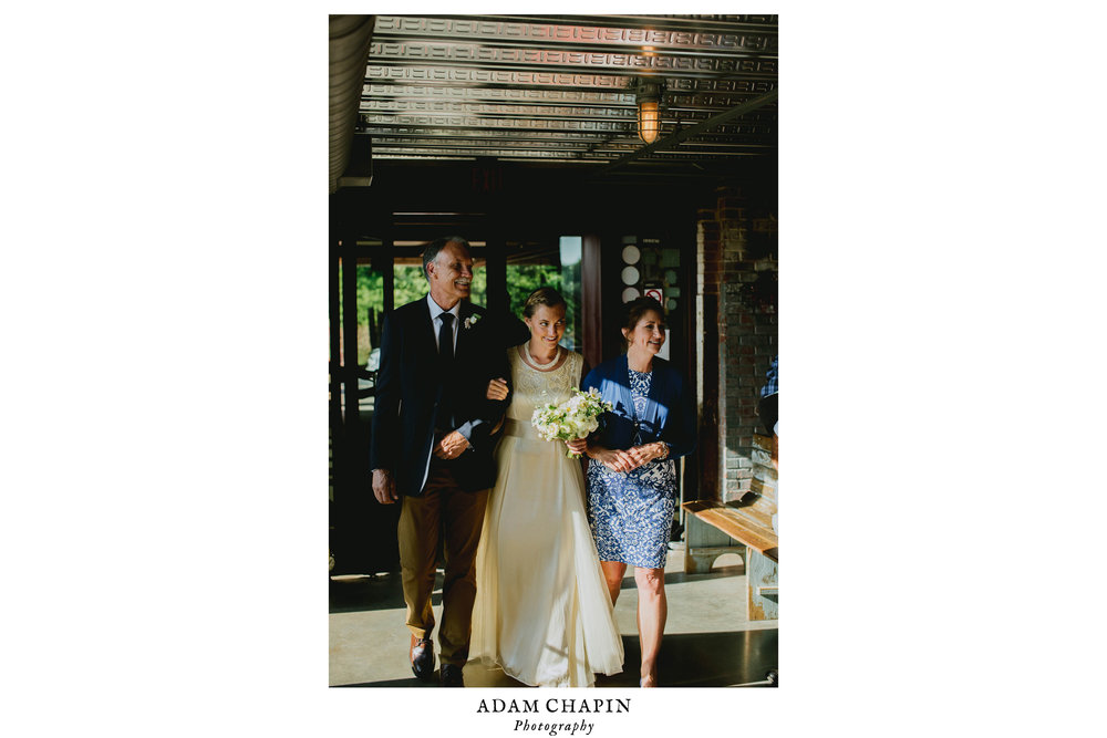 bride and her parents during the processional before her haw river ballroom wedding ceremony