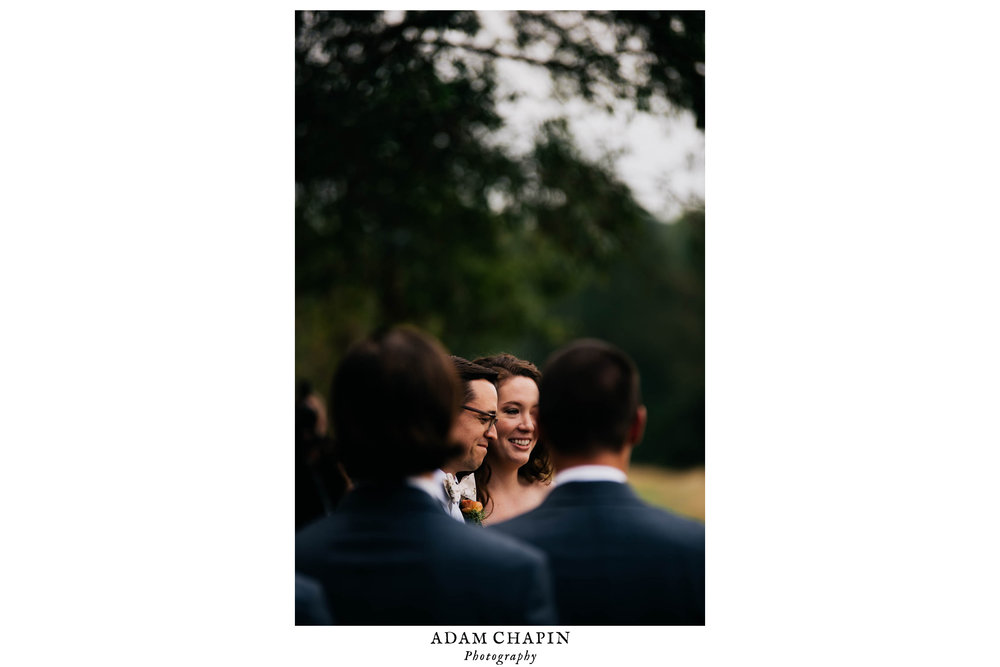 bride and groom listening to the wedding officiant during their ceremony