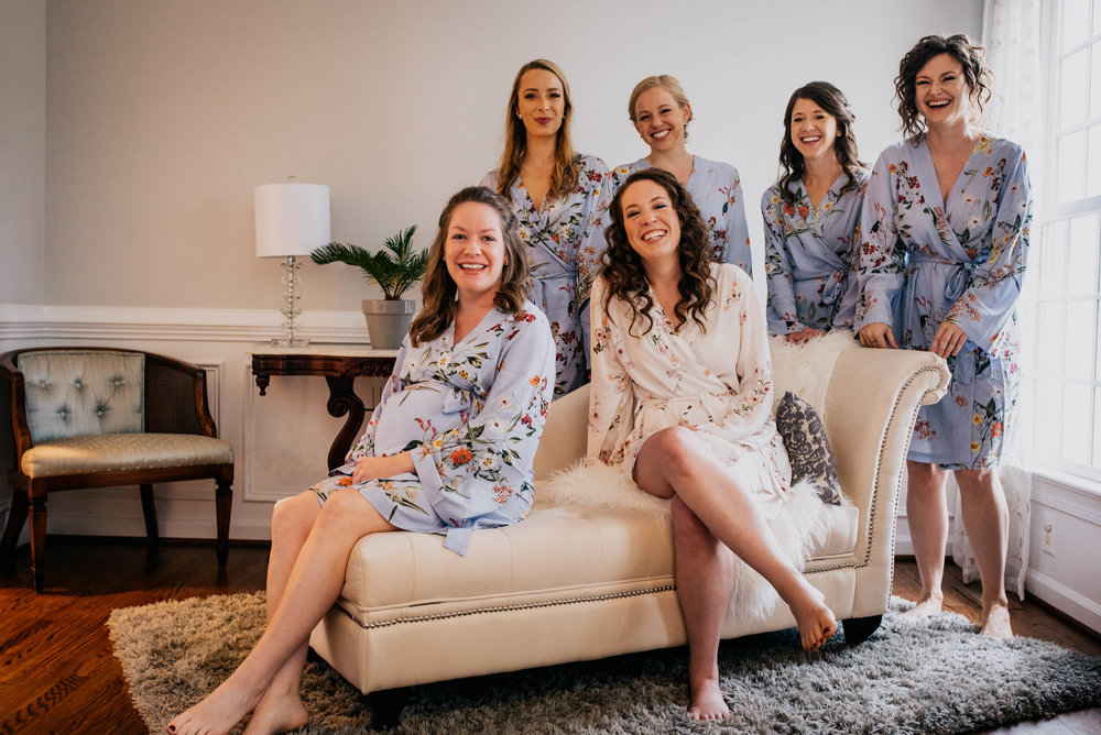 portrait of the bride and her bridesmaids in their custom robes before they get ready for the wedding day