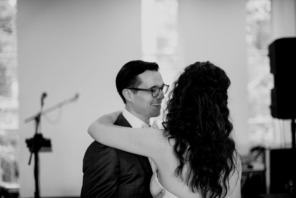 black and white photo of the bride and groom enjoying their first dance