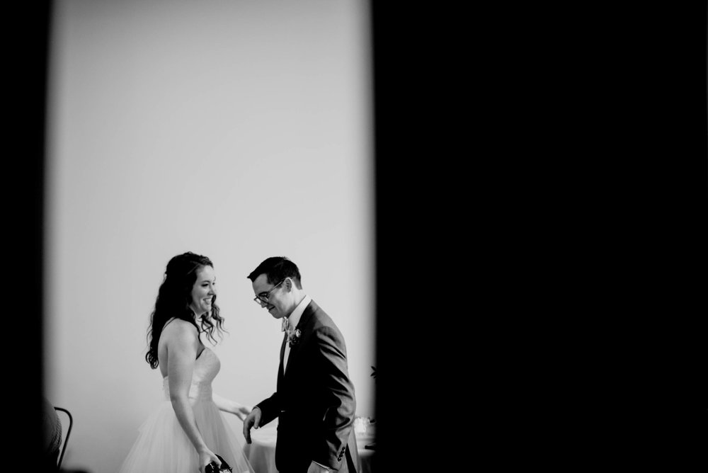 bride and groom laughing together during their wedding reception