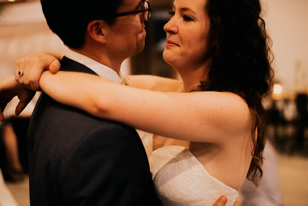 bride and groom dancing during their wedding reception