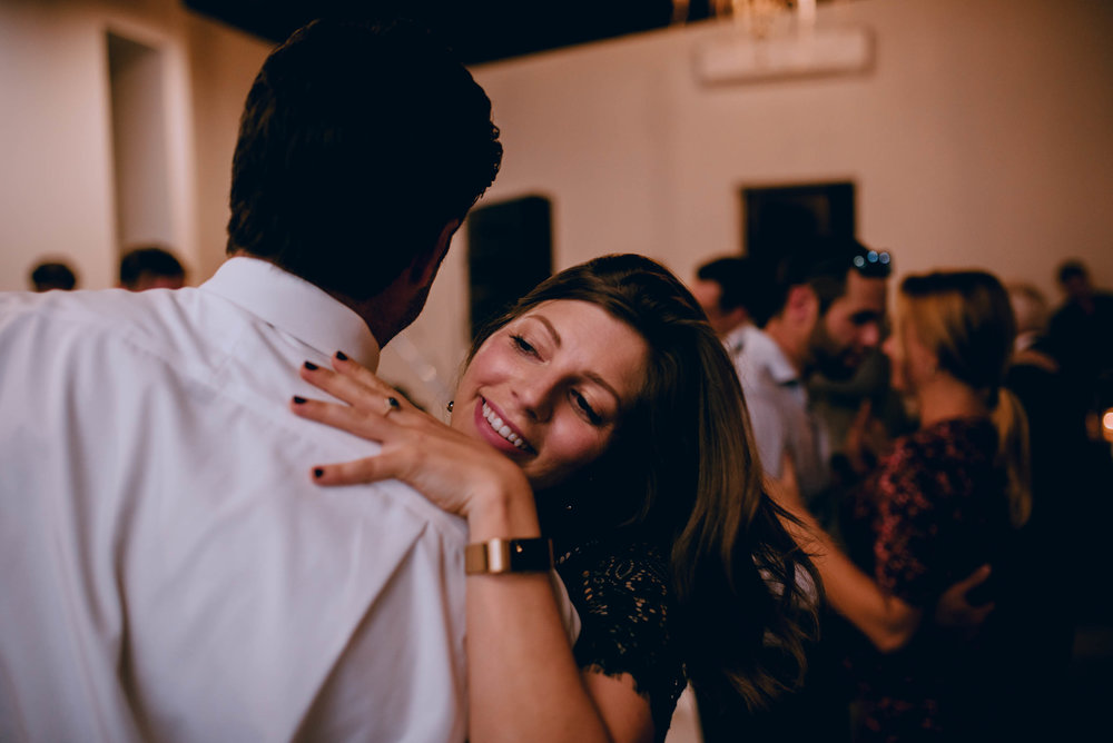 wedding guests dancing and laughing during wedding reception