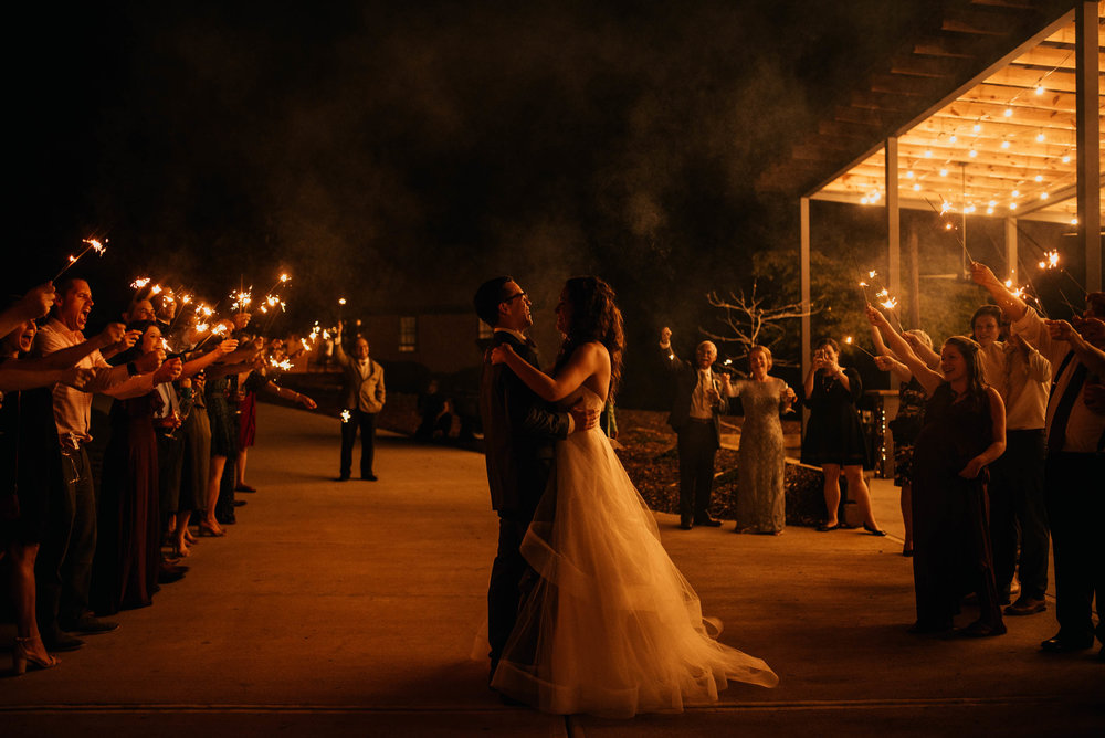 bride and groom share one last moment during sparkler exit on their wedding evening
