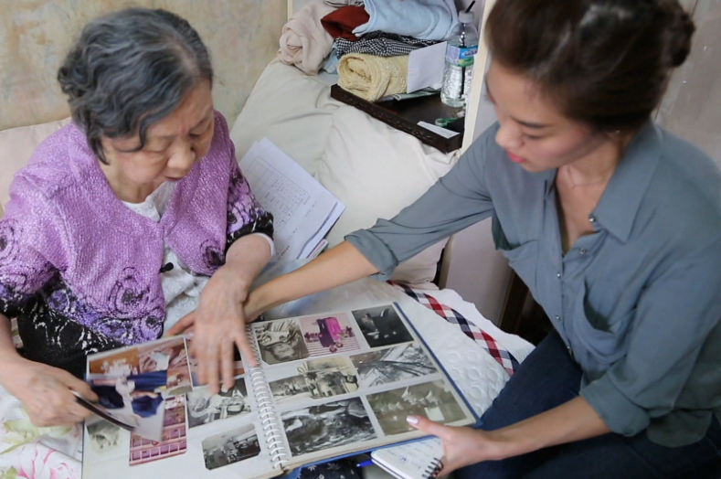 Hong Sin-ja shows me an early family photo album Photo credit: HK