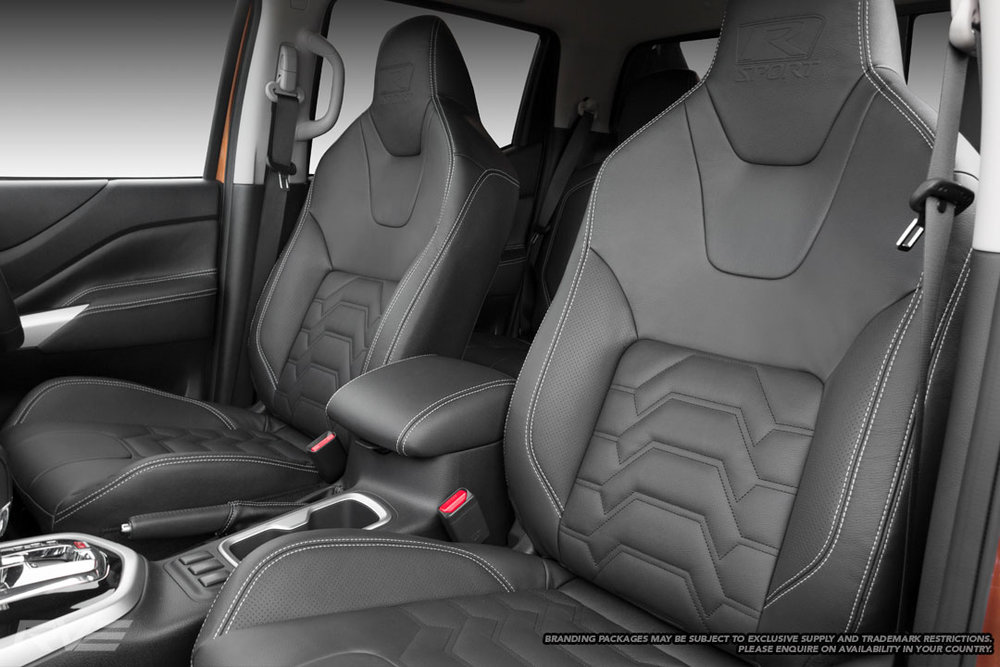 Upgraded Tombstone seats in black leather, perforated inner bolsters, silver stitching, black Armour inserts and embossed R-Sport logos.
