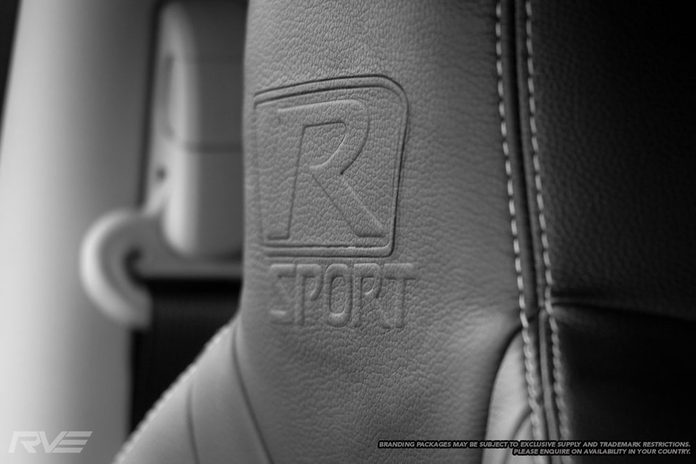 Upgraded Tombstone seats in black leather  with silver stitching and embossed R-Sport logos.