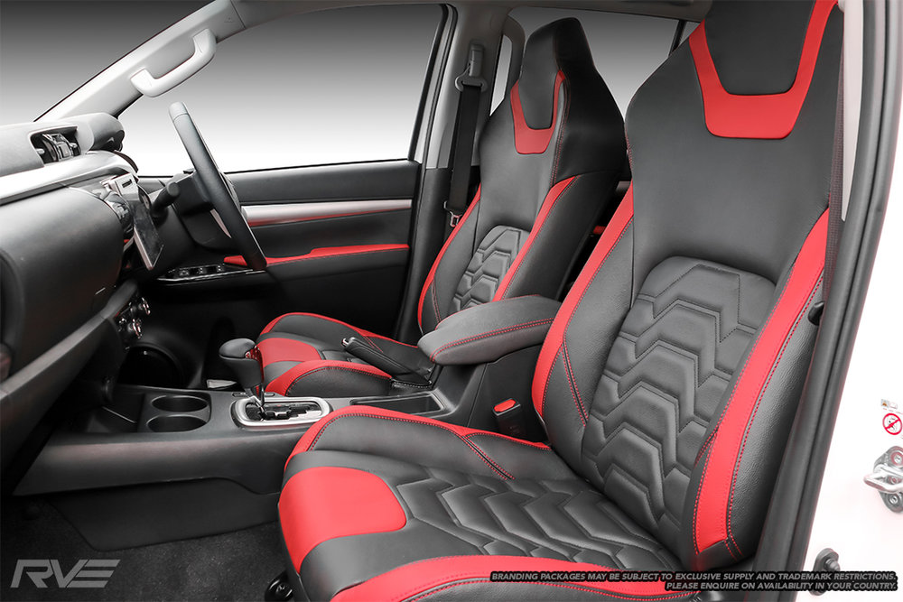 Upgraded tombstone sports seats in black leather with red highlights on bib, tongue and outer bolsters, black stitched 'Armour' inserts, and red stitching.