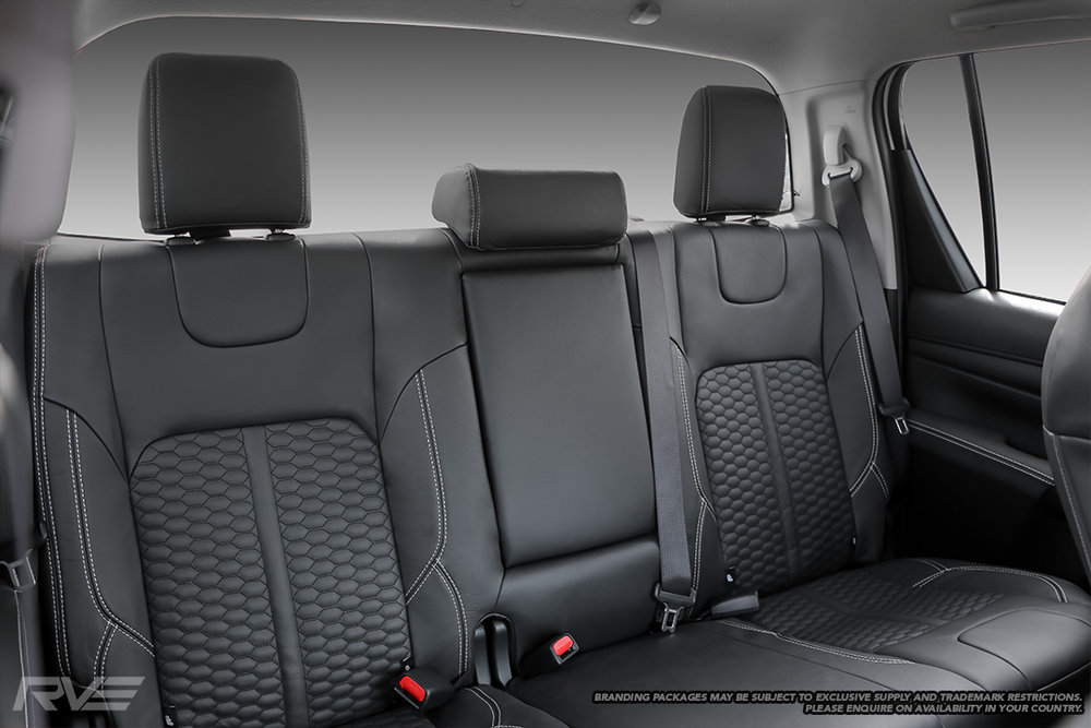 Upgraded tombstone sports seats in black leather with silver stitching and black stitched honeycomb inserts.