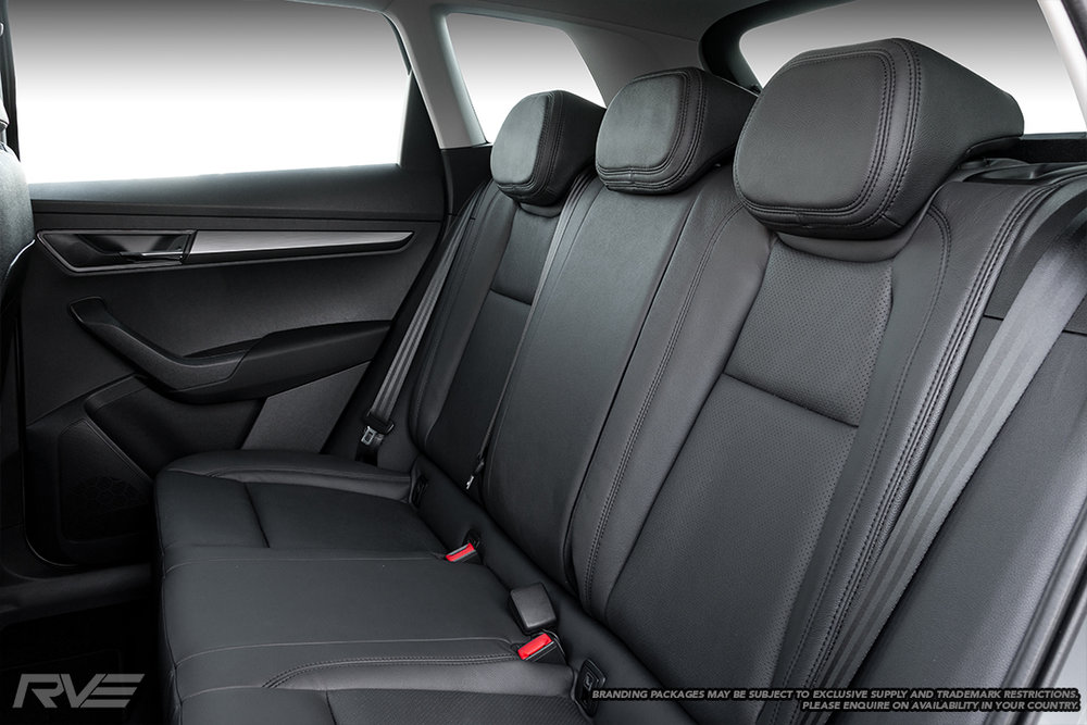 Skoda Karoq Ambition with upgraded interior in black leather with black stitching and perforated inserts.