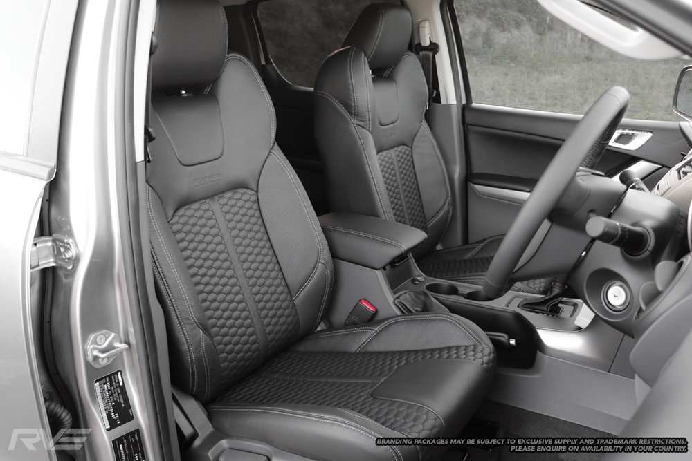 Upgraded sport seats in black leather with silver stitching, black stitched honeycomb inserts and perforated inner bolsters.