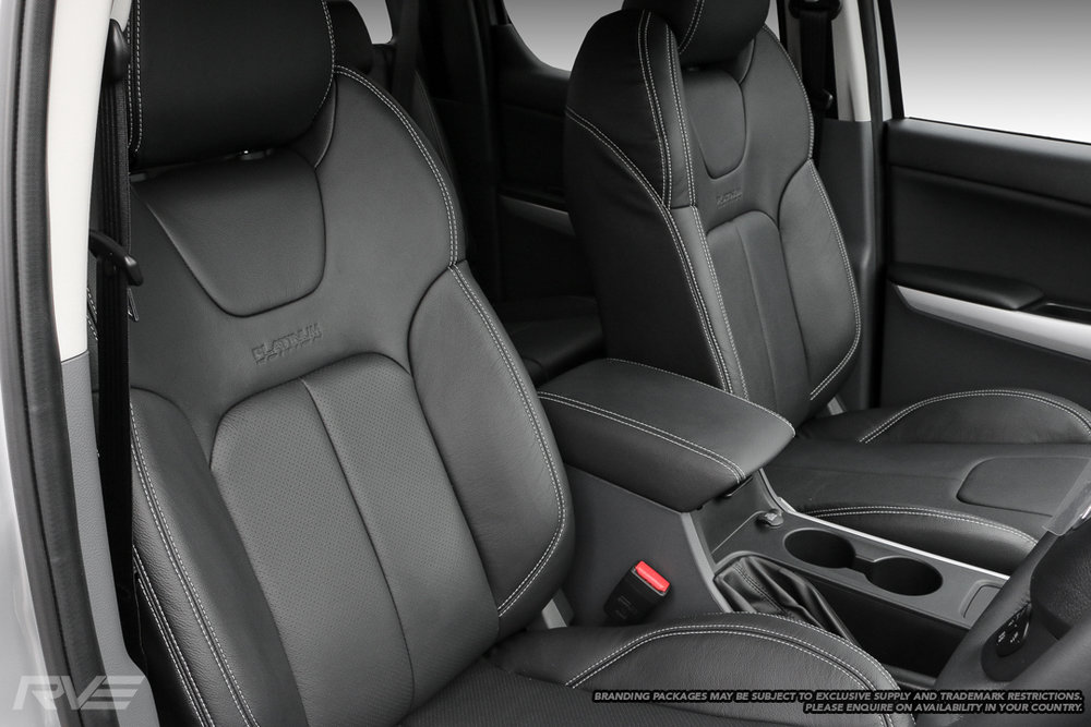 Upgraded sport seats in black leather with silver stitching, perforated inserts and embossed logos.