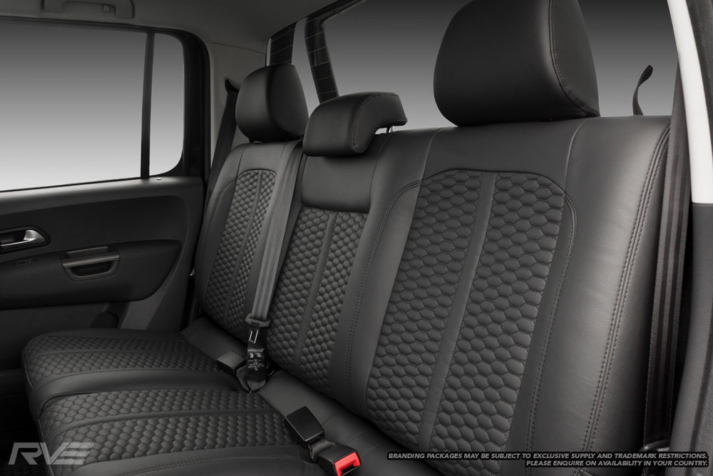 VW Amarok tombstone sport seats in black leather with black stitching and honeycomb inserts.