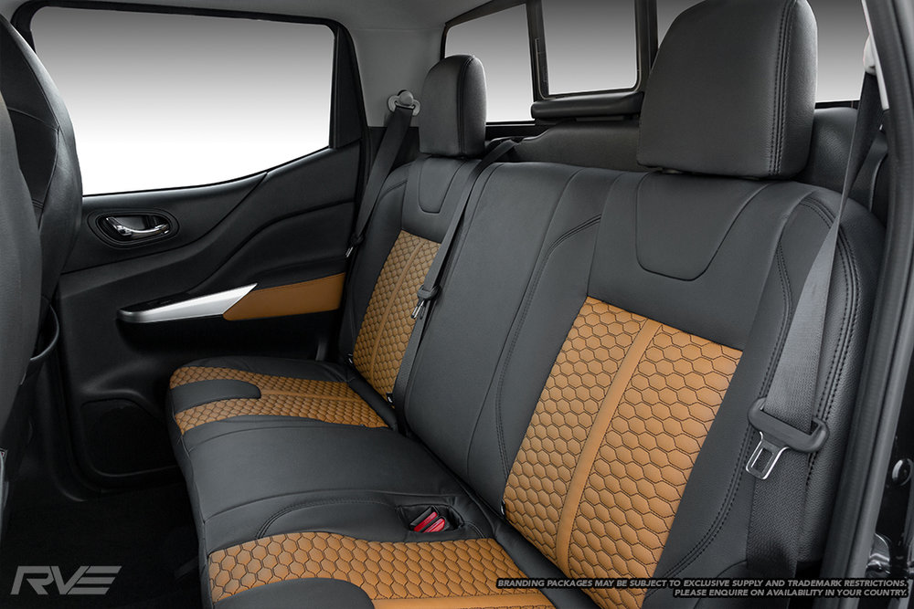 Upgraded tombstone sport seats in black leather with butterscotch honeycomb inserts and black stitching.