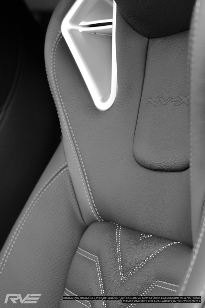 Upgraded race-inspired 'Monza' sport seats in black leather with silver stitched 'X' inserts, perforated inner-bolsters, sulphur bolster highlights, 'NV-X' embossed logos and satin silver bolster inserts.  Patent pending #NZ 746521. Design registration #424982, 424983