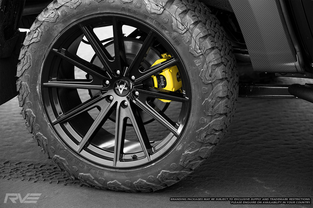 "20"" Intrepid wheels in gloss black with Black Bear A/T tyres and yellow painted brake calipers"
